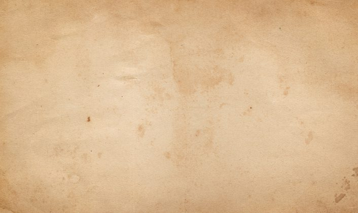 Aged dirty paper background for the design. Natural old paper texture.